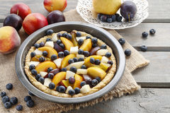 Tart with peach, pumpkin, plum, pear and blueberry Royalty Free Stock Images