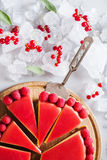Tart, pie, cake with jellied and fresh raspberry on the light concrete background. Decorated with ice and fresh berries and mint. Top view Royalty Free Stock Photography
