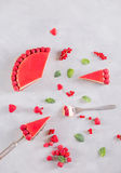Tart, pie, cake with jellied and fresh raspberry on the light concrete background. Slice of cake Stock Photos
