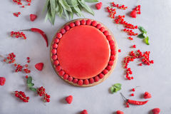 Tart, pie, cake with jellied and fresh raspberry on the light concrete background. Top view. Sweet food photo concept Stock Image