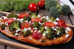 Tart quiche with broccoli tomato and goat cheese Stock Photo