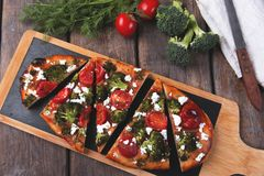 Tart quiche with broccoli tomato and goat cheese Stock Photos