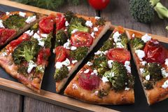 Tart quiche with broccoli tomato and goat cheese Royalty Free Stock Images