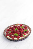 Tart with raspberries Stock Images