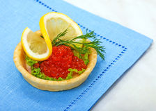 Tart with red salmon caviar Royalty Free Stock Photography