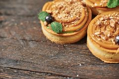 Tart with salted caramel french dessert. Food industry, mass or volume production. Dessert on wooden background stock image