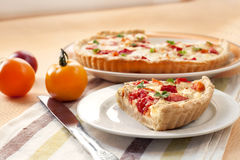Tart with salted sheep cheese and tomatoes Stock Images