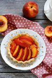 Tart with slice of  peach, Royalty Free Stock Photography