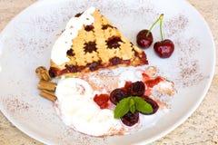 Tart With Sour Cherry Jam. Food & Drinks - Slice of tart with sour cherry jam Stock Images