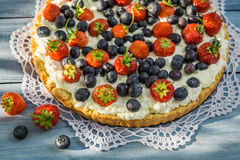 Tart with strawberries and blueberries Royalty Free Stock Image