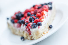 Tart with strawberries and blueberries Stock Photos