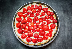 Tart with strawberries. On a plate Stock Image