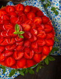 Tart with strawberries and whipped cream decorated Royalty Free Stock Image