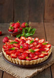 Tart with strawberries and whipped cream Royalty Free Stock Images