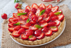Tart with strawberries and whipped cream Stock Image