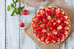 Tart with strawberries and whipped cream Royalty Free Stock Photos