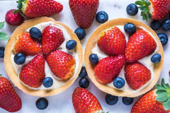 Tart with strawberry and blueberry fruits Stock Image