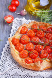 Tart with tomatoes. And herbs Stock Image