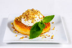 Tart and topped cream with walnuts Royalty Free Stock Photography
