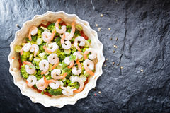 Tart with vegetables and prawns ready for baking. Stock Photo