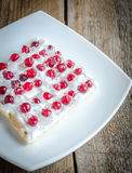 Tart with whipped cream and fresh cranberries Stock Images