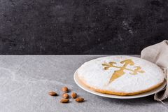 Tarta de Santiago. Traditional almond cake from Santiago in Spain. On gray background. Copyspace royalty free stock photography