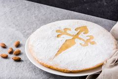 Tarta de Santiago. Traditional almond cake from Santiago in Spain. On gray background stock photography