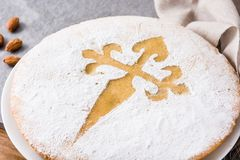 Tarta de Santiago. Traditional almond cake from Santiago in Spain. On gray background. Close up stock photo