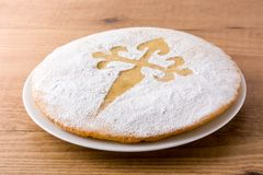 Tarta de Santiago. Traditional almond cake from Santiago in Spain on wooden table.  royalty free stock photo
