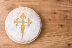 Tarta de Santiago. Traditional almond cake from Santiago in Spain on wooden table. Top view. Copyspace royalty free stock images