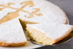 Tarta de Santiago. Traditional almond cake slice from Santiago in Spain on gray background. Close up stock photography
