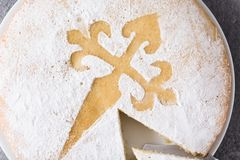 Tarta de Santiago. Traditional almond cake slice from Santiago in Spain on gray background. Close up royalty free stock photos