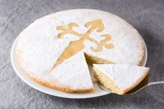 Tarta de Santiago. Traditional almond cake slice from Santiago in Spain. On gray background royalty free stock photo
