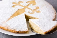 Tarta de Santiago. Traditional almond cake slice from Santiago in Spain. On gray background. Close up stock photography