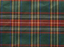 Tartan background. Traditional Scottish tartan textile pattern useful as a background Stock Photos