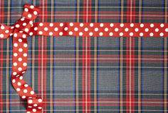 Tartan background texture with polka dots and red ribbon Stock Photos