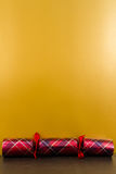Tartan Christmas cracker with blank space above. Stock Images