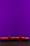 Tartan Christmas cracker with blank space above. Stock Photography