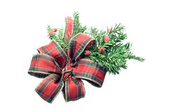 Tartan christmas ribbon. Tartan christmas bow isolated on white with pine sprig Stock Images