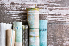 Tartan fabrics. Blue and cream tartan fabric rolls Stock Image