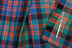 Tartan Kilt and Dagger Brooch Royalty Free Stock Image