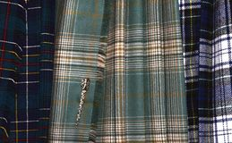 Tartan kilts come in many colors and patterns. For each clan or family, there are often numerous other official or unofficial variations. Tartan Day is a stock image
