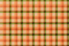 Tartan Orange and green pattern - Plaid Clothing Table. Plaid is a pattern consisting of crossed horizontal and vertical bands in two or more colours in woven Royalty Free Stock Images