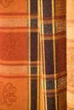 Tartan pattern fabric. Detail of a tartan pattern in pleated fabric Royalty Free Stock Photography