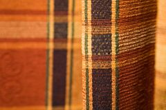 Tartan pattern fabric. Detail of a tartan pattern in pleated fabric Royalty Free Stock Images