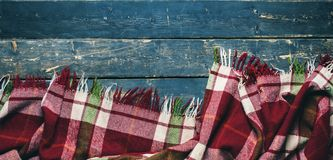 Tartan plaid on black old vintage wooden planks. Top view background long banner Royalty Free Stock Photography