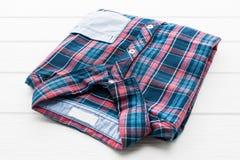 Tartan or Plaid shirt. On white wooden background Stock Photo