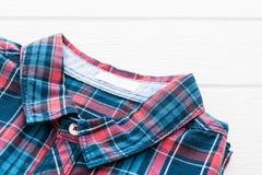 Tartan or Plaid shirt. On white wooden background Stock Photos