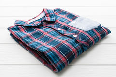 Tartan or Plaid shirt. On white wooden background Stock Images