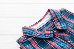 Tartan or Plaid shirt. On white wooden background Stock Photography